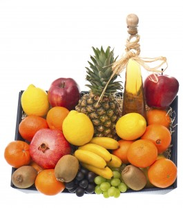 assorted fruits and bottle of wine